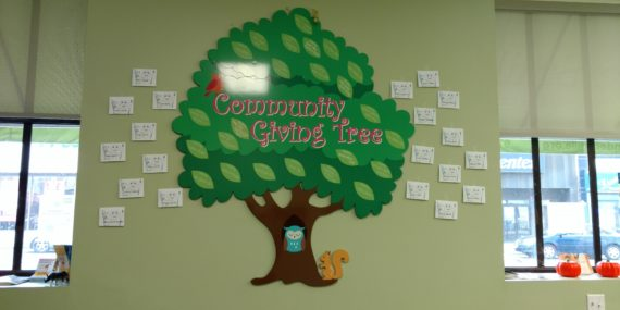 Photo of Community Giving Tree with donor names in dental home
